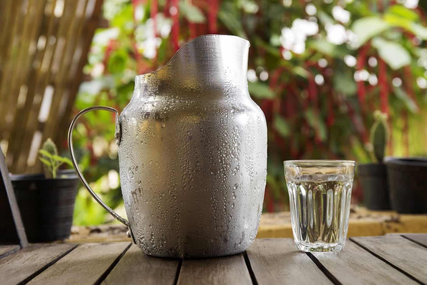 A Glass and Metal Jug of water